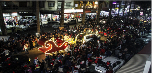 Photo of كرنفال الميلاد يجول شوارع طرطوس:  استعادة رسالة الحب والفرح السوري